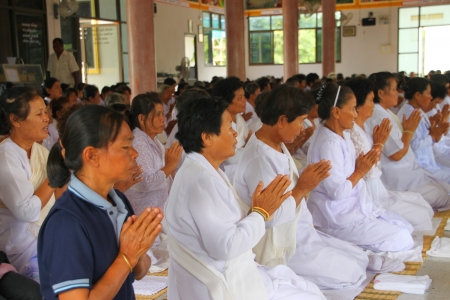 MUANG, MAHASARAKHAM - AUGUST 25 : Unidentified Buddhists are making religious merit as usual in Buddhist holy day on August 25, 2012 at Wat Sratong Teparam, Muang, Mahasarakham, Thailand.