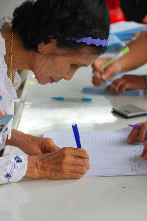 MUANG, MAHASARAKHAM - AUGUST 28 : Unidentified voter is voting village headman on August 28, 2012 at village hall, Ban Dong Noi, Wang Nang, Muang, Mahasarakham, Thailand. Stock Photo - 15079657