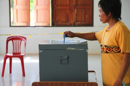 election commission: MUANG, MAHASARAKHAM - SEPTEMBER 4 : Unidentified voter is voting village headman on September 4, 2012 at Wat Ban Hin Lat, Tha Song Kon, Muang, Mahasarakham, Thailand. Editorial