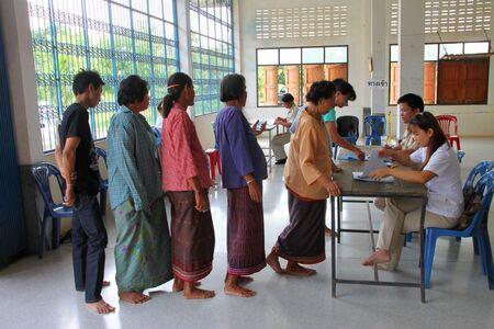 election commission: MUANG, MAHASARAKHAM - SEPTEMBER 4 : Unidentified voters are in queue of voting village headman on September 4, 2012 at Wat Ban Hin Lat, Tha Song Kon, Muang, Mahasarakham, Thailand.