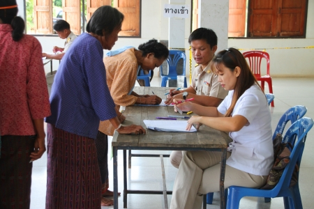 electoral system: MUANG, MAHASARAKHAM - SEPTEMBER 4 : Unidentified voters are in queue of voting village headman on September 4, 2012 at Wat Ban Hin Lat, Tha Song Kon, Muang, Mahasarakham, Thailand.