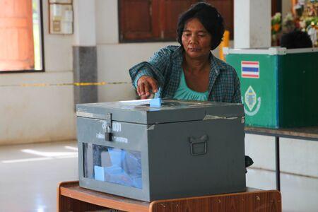 voter: MUANG, MAHASARAKHAM - SEPTEMBER 4 : Unidentified voter is voting village headman on September 4, 2012 at Wat Ban Hin Lat, Tha Song Kon, Muang, Mahasarakham, Thailand. Editorial