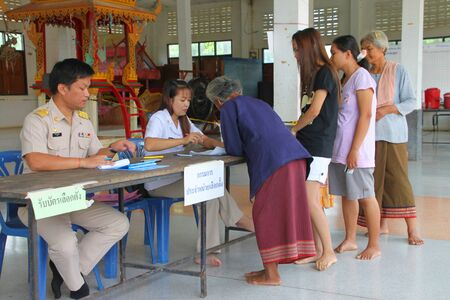 headman: MUANG, MAHASARAKHAM - SEPTEMBER 4 : Unidentified voters are in queue of voting village headman on September 4, 2012 at Wat Ban Hin Lat, Tha Song Kon, Muang, Mahasarakham, Thailand.