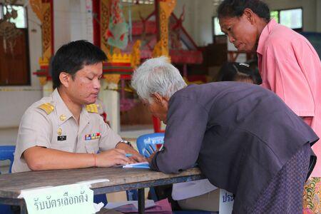 free vote: MUANG, MAHASARAKHAM - SEPTEMBER 4 : Unidentified voters are in queue of voting village headman on September 4, 2012 at Wat Ban Hin Lat, Tha Song Kon, Muang, Mahasarakham, Thailand.