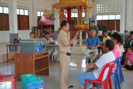 election commission: MUANG, MAHASARAKHAM - SEPTEMBER 4 : Unidentified officer is explaning how to count votes village headman on September 4, 2012 at Wat Ban Hin Lat, Tha Song Kon, Muang, Mahasarakham, Thailand.