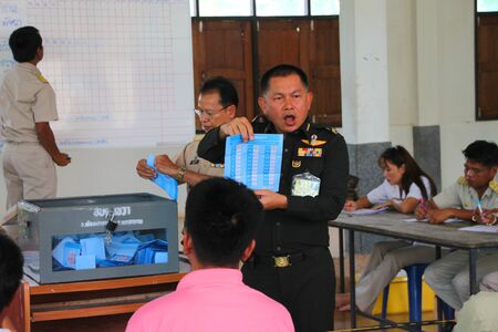 MUANG, MAHASARAKHAM - SEPTEMBER 4 : Unidentified officers are counting votes village headman on September 4, 2012 at Wat Ban Hin Lat, Tha Song Kon, Muang, Mahasarakham, Thailand. Stock Photo - 15079666