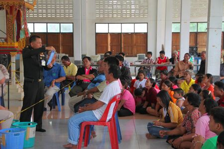 MUANG, MAHASARAKHAM - SEPTEMBER 4 : Unidentified voters are seeing officer counting votes village headman on September 4, 2012 at Wat Ban Hin Lat, Tha Song Kon, Muang, Mahasarakham, Thailand. Stock Photo - 15079676