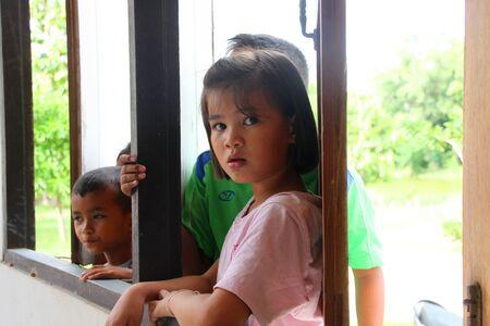 MUANG, MAHASARAKHAM - SEPTEMBER 4 : Unidentified children are seeing officer counting votes village headman on September 4, 2012 at Wat Ban Hin Lat, Tha Song Kon, Muang, Mahasarakham, Thailand. Stock Photo - 15079661