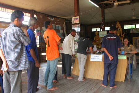election commission: MUANG, MAHASARAKHAM - SEPTEMBER 7 : Unidentified voters are in queue for voting village headman on September 7, 2012 at Wat Ban Jam Nak, Nong Pling, Muang, Mahasarakham, Thailand.