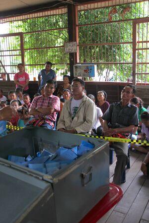MUANG, MAHASARAKHAM - SEPTEMBER 7 : Unidentified voters are seeing officers counting votes village headman on September 7, 2012 at Wat Ban Jam Nak, Nong Pling, Muang, Mahasarakham, Thailand. Stock Photo - 15102450