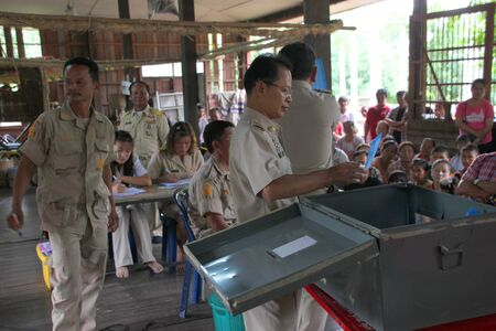 MUANG, MAHASARAKHAM - SEPTEMBER 7 : Unidentified officers are counting votes village headman on September 7, 2012 at Wat Ban Jam Nak, Nong Pling, Muang, Mahasarakham, Thailand.