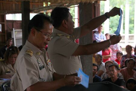 MUANG, MAHASARAKHAM - SEPTEMBER 7 : Unidentified officers are counting votes village headman on September 7, 2012 at Wat Ban Jam Nak, Nong Pling, Muang, Mahasarakham, Thailand. Stock Photo - 15102432