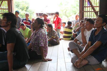 headman: MUANG, MAHASARAKHAM - SEPTEMBER 7 : Unidentified voters are seeing officers counting votes village headman on September 7, 2012 at Wat Ban Jam Nak, Nong Pling, Muang, Mahasarakham, Thailand. Editorial