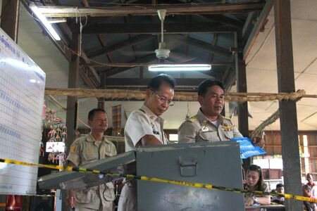 MUANG, MAHASARAKHAM - SEPTEMBER 7 : Unidentified officers are counting votes village headman on September 7, 2012 at Wat Ban Jam Nak, Nong Pling, Muang, Mahasarakham, Thailand.