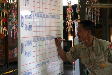 MUANG, MAHASARAKHAM - SEPTEMBER 7 : Unidentified officer is counting votes village headman on September 7, 2012 at Wat Ban Jam Nak, Nong Pling, Muang, Mahasarakham, Thailand. Stock Photo - 15102453