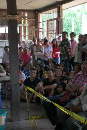 MUANG, MAHASARAKHAM - SEPTEMBER 7 : Unidentified voters are seeing officers counting votes village headman on September 7, 2012 at Wat Ban Jam Nak, Nong Pling, Muang, Mahasarakham, Thailand. Stock Photo - 15102437