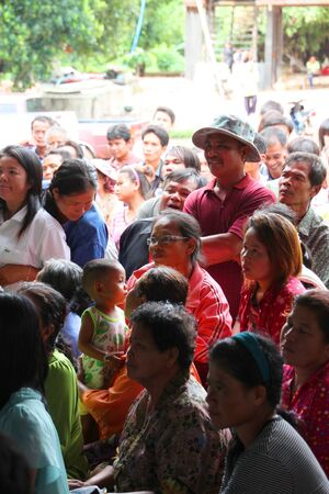 MUANG, MAHASARAKHAM - SEPTEMBER 7 : Unidentified voters are seeing officers counting votes village headman on September 7, 2012 at Wat Ban Jam Nak, Nong Pling, Muang, Mahasarakham, Thailand. Stock Photo - 15102433