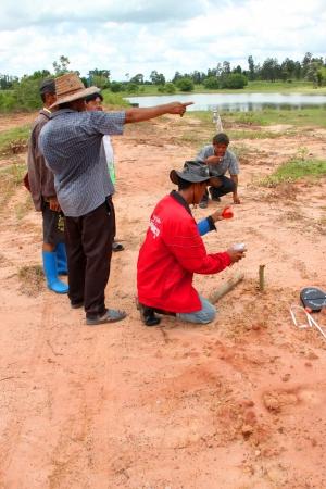 MUANG, MAHASARAKHAM - SEPTEMBER 10 : Unidentified men are surveying location area to build a big dam on September 10, 2012 at local reservoir, Bua Kor, Muang, Mahasarakham, Thailand. Stock Photo - 15156394