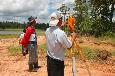 architectural survey: MUANG, MAHASARAKHAM - SEPTEMBER 10 : Unidentified men are surveying location area to build a big dam on September 10, 2012 at local reservoir, Bua Kor, Muang, Mahasarakham, Thailand.