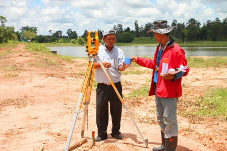 MUANG, MAHASARAKHAM - SEPTEMBER 10 : Unidentified men are surveying location area to build a big dam on September 10, 2012 at local reservoir, Bua Kor, Muang, Mahasarakham, Thailand.