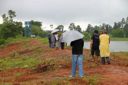 geodesist: MUANG, MAHASARAKHAM - SEPTEMBER 2 : Unidentified men are surveying location area to build a big dam on September 2, 2012 at local reservoir, Bua Kor, Muang, Mahasarakham, Thailand.