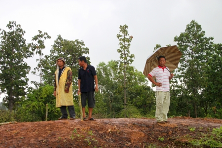 MUANG, MAHASARAKHAM - SEPTEMBER 2 : Unidentified men are surveying location area to build a big dam on September 2, 2012 at local reservoir, Bua Kor, Muang, Mahasarakham, Thailand.