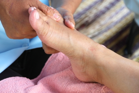 Reflexology massage, spa foot treatment,Thailand photo