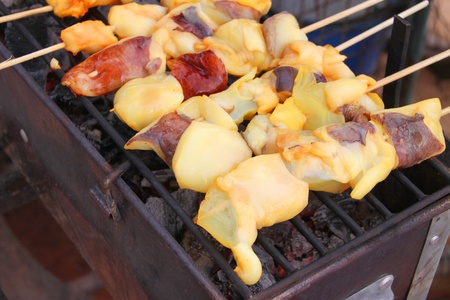 Seafood barbecue of grilled squids on gridiron charcoal stove Stock Photo - 15420399