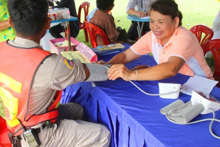 MUANG, MAHASARAKHAM - SEPTEMBER 19 : Unidentified nurse is giving healthcare services in public secter services mobile project on September 19, 2012 at Wat Don Whan, Muang, Mahasarakham, Thailand. Stock Photo - 15453190