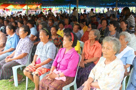 MUANG, MAHASARAKHAM - SEPTEMBER 19 : Unidentified villagers are waiting for visiting of provincial governor in public secter services mobile project on September 19, 2012 at Wat Don Whan, Muang, Mahasarakham, Thailand. Stock Photo - 15454550