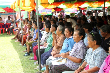 MUANG, MAHASARAKHAM - SEPTEMBER 19 : Unidentified villagers are waiting for visiting of provincial governor in public secter services mobile project on September 19, 2012 at Wat Don Whan, Muang, Mahasarakham, Thailand.