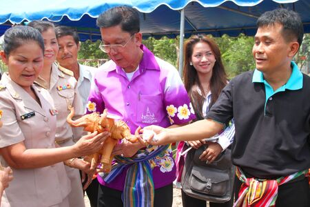 MUANG, MAHASARAKHAM - SEPTEMBER 13 : Unidentified village leader is giving souvenirs to provincial governor and tourists on September 13, 2012 at Ban Moh (Pottery village), Muang, Mahasarakham, Thailand.