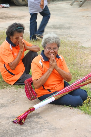 MUANG, MAHASARAKHAM - OCTOBER 5 : Unidentified old women are preparing to perform wooden staff dance in healthy way of life festival on October 5, 2012 at sport ground, Kerng local administration institute, Muang, Mahasarakham, Thailand.