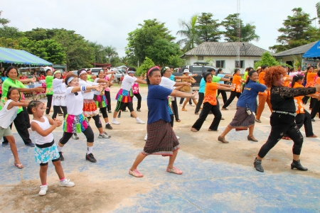 MUANG, MAHASARAKHAM - OCTOBER 5 : Unidentified villagers are performing aerobic dance in healthy way of life festival on October 5, 2012 at sport ground, Kerng local administration institute, Muang, Mahasarakham, Thailand.