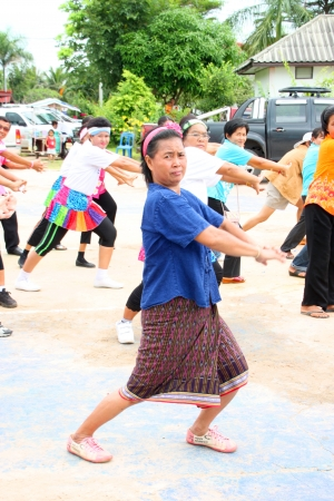 MUANG, MAHASARAKHAM - OCTOBER 5 : Unidentified villagers are performing aerobic dance in healthy way of life festival on October 5, 2012 at sport ground, Kerng local administration institute, Muang, Mahasarakham, Thailand. Stock Photo - 15620974