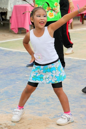 MUANG, MAHASARAKHAM - OCTOBER 5 : Unidentified girl is performing aerobic dance in healthy way of life festival on October 5, 2012 at sport ground, Kerng local administration institute, Muang, Mahasarakham, Thailand.