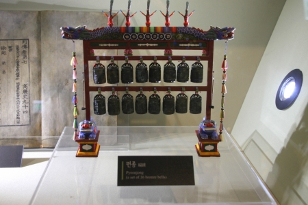 A set of 16 bronze bells - The story of King Sejong in museum under King Sejong statue in front of Seoul city hall, Central Seoul, South Korea.