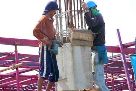 MUANG, BURIRAM - SEPTEMBER 23 : Unidentified men are working in the building site on September 23, 2012 at Taweekit Plaza, Muang, Buriram, Thailand.