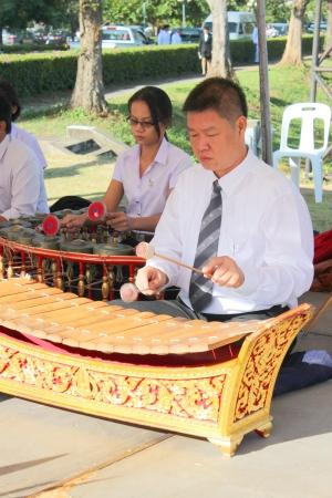 venerate: MUANG, MAHASARAKHAM - OCTOBER 23 : Unidentified musicians are performing Thai music in King Chulalongkorn Day (Royal Cremation) on October 23, 2012 at city hall ground, Mahasarakham, Thailand.