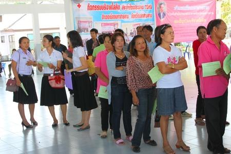 endow: MUANG, MAHASARAKHAM - OCTOBER 26 : Unidentified sacrificers are in blood donation activities on October 26, 2012 at Padung Nari school hall, Muang, Mahasarakham, Thailand. Editorial