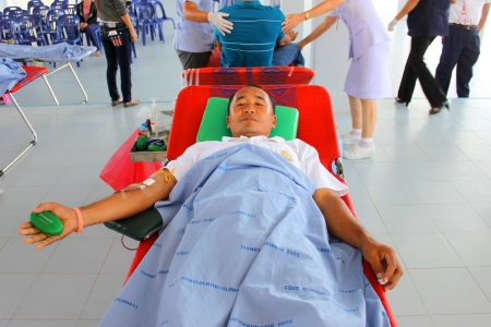 MUANG, MAHASARAKHAM - OCTOBER 26 : Unidentified sacrificers are in blood donation activities on October 26, 2012 at Padung Nari school hall, Muang, Mahasarakham, Thailand.