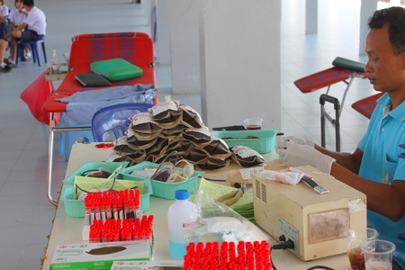 MUANG, MAHASARAKHAM - OCTOBER 26 : Unidentified hospital officer is in blood donation activities on October 26, 2012 at Padung Nari school hall, Muang, Mahasarakham, Thailand.