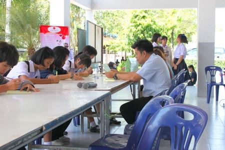 MUANG, MAHASARAKHAM - OCTOBER 26 : Unidentified sacrificers are writing biography and in blood donation activities on October 26, 2012 at Padung Nari school hall, Muang, Mahasarakham, Thailand. Stock Photo - 15944420