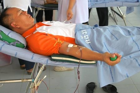 MUANG, MAHASARAKHAM - OCTOBER 26 : Unidentified sacrificers are in blood donation activities on October 26, 2012 at Padung Nari school hall, Muang, Mahasarakham, Thailand.