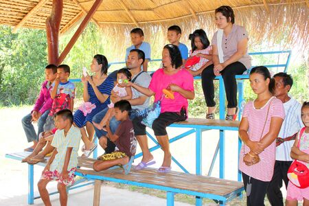 THA TUM, SURIN, THAILAND - OCTOBER 28 : Unidentified tourists are watching snake show on October 28, 2012 at elephant study center, Ban Ta Klang, Tha Tum, Surin, Thailand.