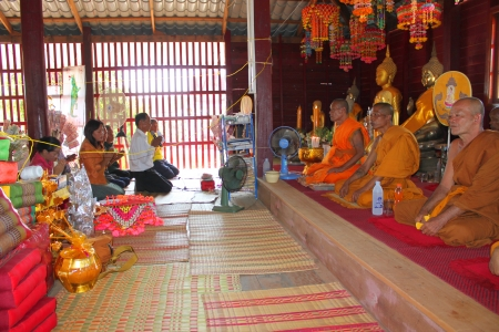 priest's ritual robes: MUANG, MAHASARAKHAM - NOVEMBER 9 : Unidentified Buddhists are making religious ceremony  in which yellow robes are presented to the priests at the end of Buddhist Lent on November 9, 2012 at Nong Whai temple, Tha Tum District, Muang, Mahasarakham, Thailan