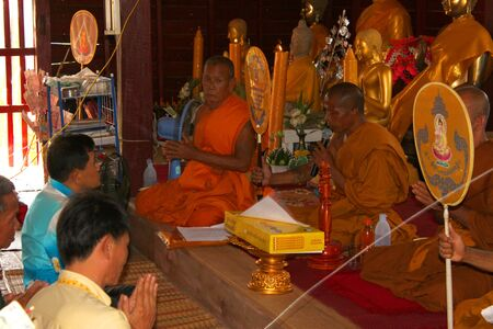 MUANG, MAHASARAKHAM - NOVEMBER 9 : Unidentified Buddhists are making religious ceremony  in which yellow robes and money are presented to the priests at the end of Buddhist Lent on November 9, 2012 at Nong Whai temple, Tha Tum District, Muang, Mahasarakha Editorial