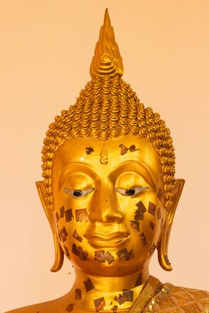Buddha image in pavilion at Wat Burapaphiram, Muang Roi-et, Thailand photo