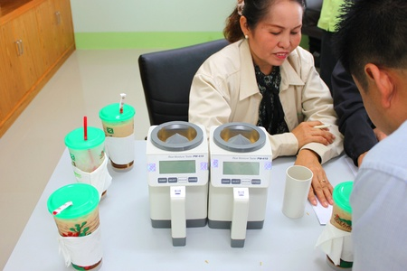 MUANG, MAHASARAKHAM - NOVEMBER 12 : Unidentified officers are inspecting equipments, tools, humidity measurement and rice silo for rice commercial public project on November 12, 2012 at Agricultural Cooperative, Muang, Mahasarakham, Thailand. Stock Photo - 16496997
