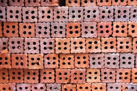 orderly: Orderly pile of construction red baked clay bricks